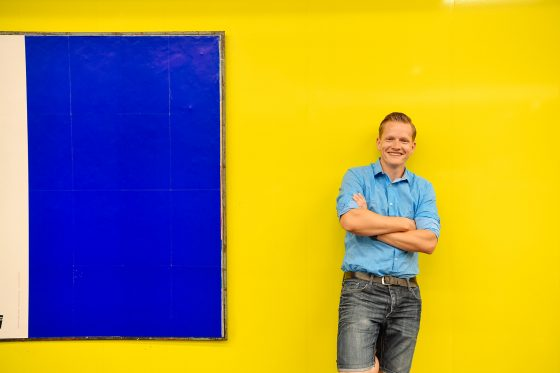 Stefan Pasch in front of a yellow wall